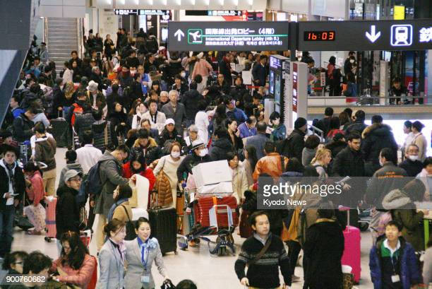 Holidaymakers crowd the arrival lobby at Narita airport near Tokyo on Jan 3 2018 at the end of their New Year's break ==Kyodo