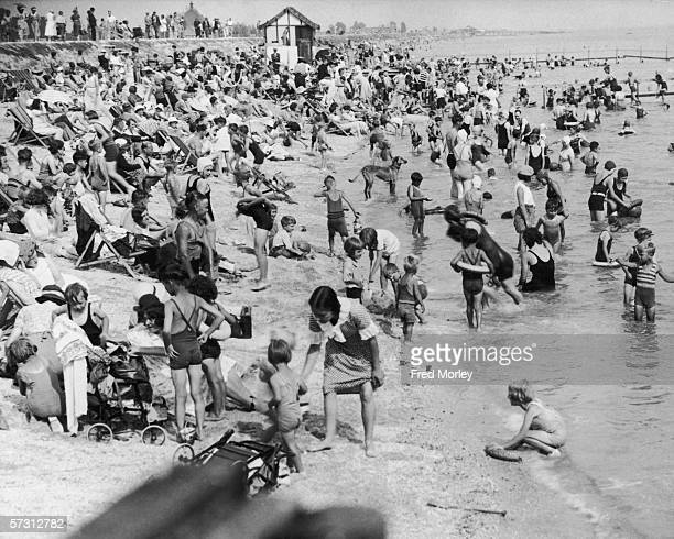 Holidaymakers crowd the beach at Canvey Island in Essex 21st August 1935