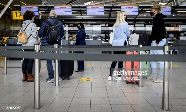Holidaymakers depart from Schiphol airport towards Gran Canaria for a test holiday, on May 1, 2021. - The aim is to see whether a test protocol makes...