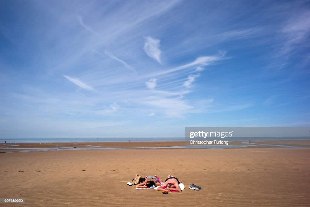 Holidaymakers enjoy the high temperatures on Blackpool beach on June 19, 2017 in Blackpool, England. The UK has officially been put on heatwave alert as the Government issued a level three amber heat warning as temperatures are set to increase. In some parts of the Uk temperatures are expected to peak at 34C.