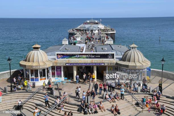 Holidaymakers enjoy the sunshine on the pier beside the town centre on August 21 2019 in Cromer England Despite dreadful August weather where the Met...
