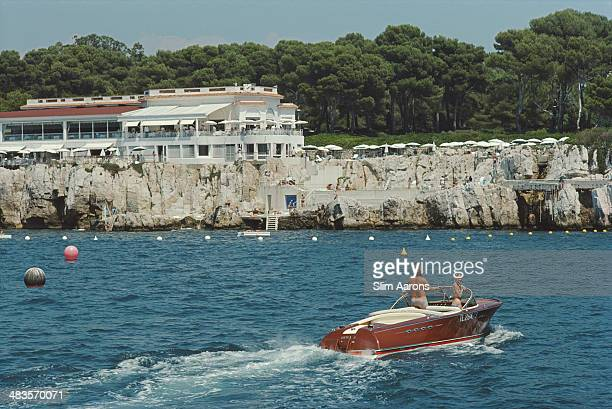 Holidaymakers in a motorboat off the Hotel du CapEdenRoc in Antibes on the French Riviera 1969