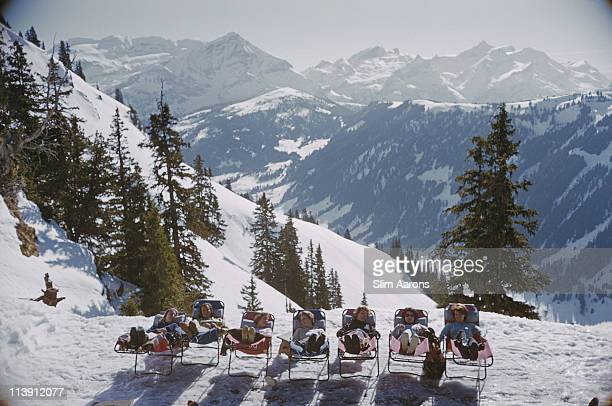 Holidaymakers in sun loungers on the slopes at at Gstaad Switzerland March 1961 1961