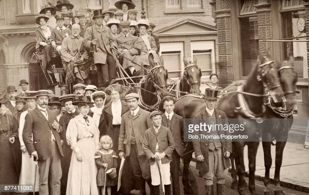 Holidaymakers in their Sunday best pose before an outing with a charabanc and horses in front of the Post Office in Shanklin on the Isle of Wight...