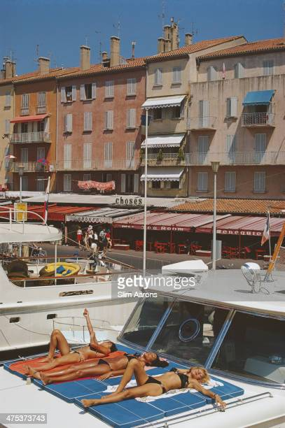 Holidaymakers lounging on the deck of their luxury yacht in SaintTropez France August 1971