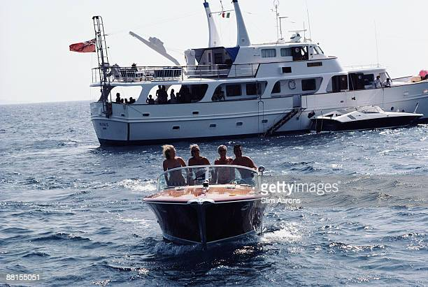 Holidaymakers on a boat trip off Porto Ercole Tuscany Italy September 1986