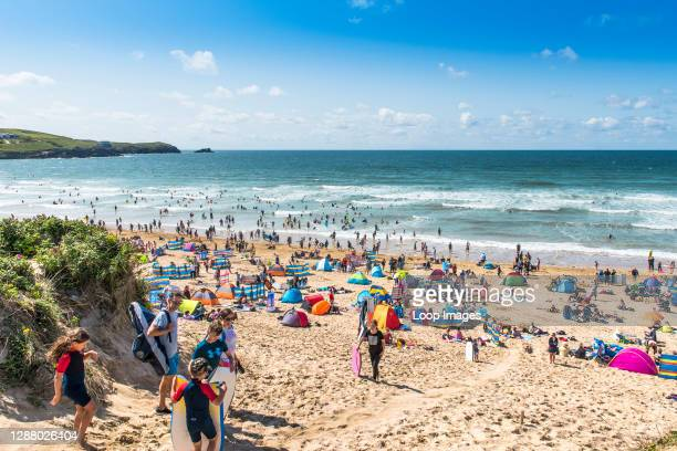 Holidaymakers on a sunny Fistral Beach in Newquay in Cornwall.