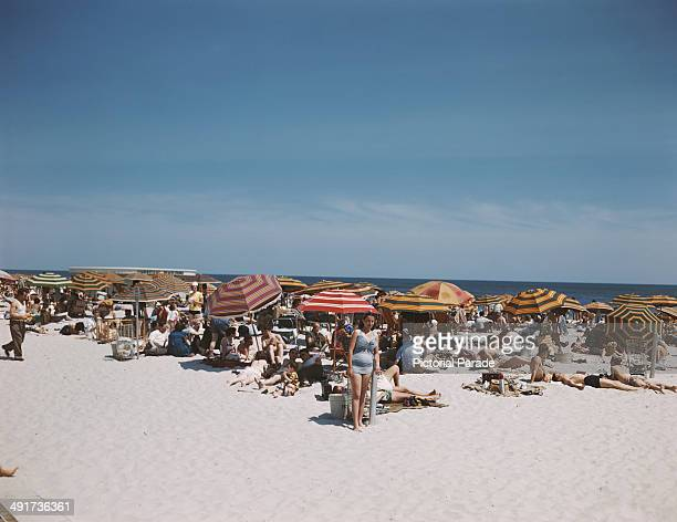 Holidaymakers on Jones Beach Island off the coast of Long Island New York State USA circa 1965