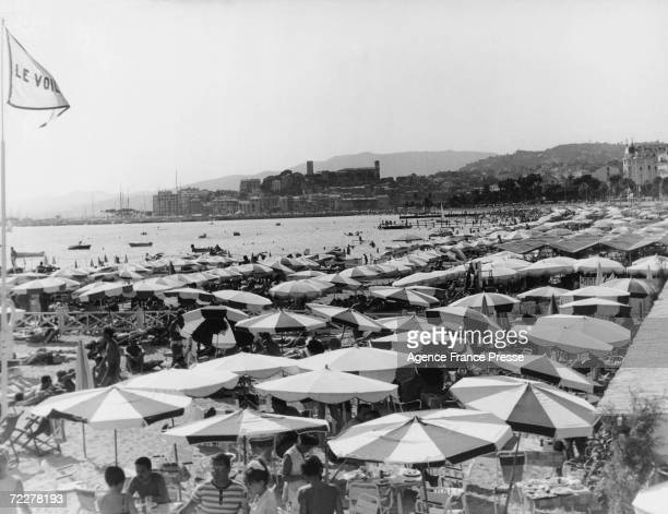 Holidaymakers on the beach at Cannes circa 1965