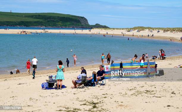 Holiday-makers on the beach on July 12, 2020 in Rock, United Kingdom. The UK government announced that Pubs, Hotels and Restaurants could open from...