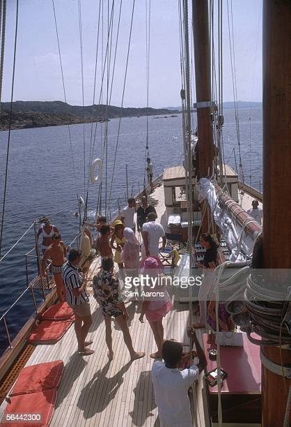 Holidaymakers on the deck of a luxury yacht off the Costa Smeralda Sardinia August 1967 Amongst them are the Aga Khan and actor Peter Sellers