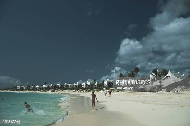 Holidaymakers on the milelong crescent beach at the Hotel Cap Jaluca resort Anguilla Leeward Islands January 1992