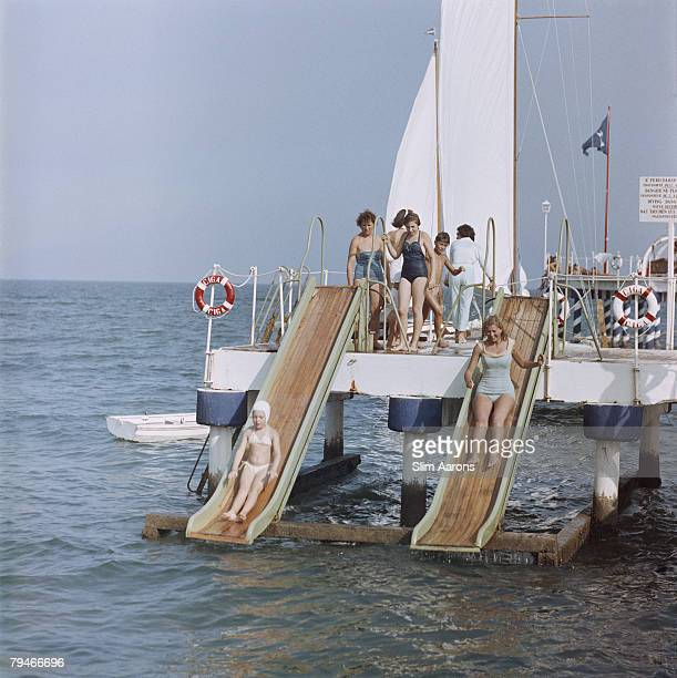 Holidaymakers on the pier at the Lido in Venice, 1957.