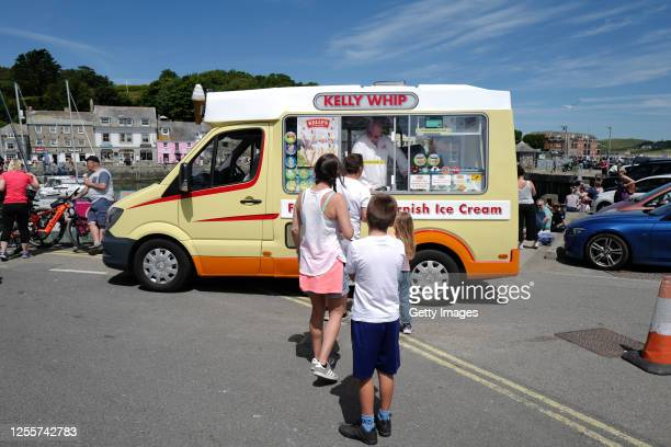 Holiday-makers queue for ice cream on July 12, 2020 in Padstow, United Kingdom. The UK government announced that Pubs, Hotels and Restaurants could...