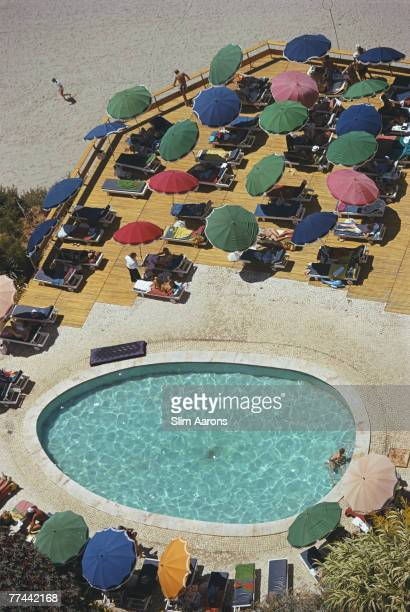 Holidaymakers round a pool Carvoeiro Portugal July 1970