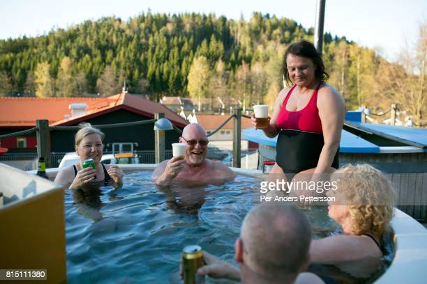 Holidaymakers share a Jacuzzi at a camping on May 5 2017 in Ullared Sweden Ullared is famous for Gekas Sweden's most famous superstore founded in...