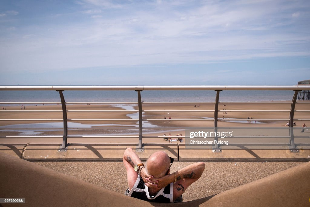 Holidaymakers sun themselves on Blackpool Promenade on June 19, 2017 in Blackpool, England. The UK has officially been put on heatwave alert as the Government issued a level three amber heat warning as temperatures are set to increase. In some parts of the Uk temperatures are expected to peak at 34C.