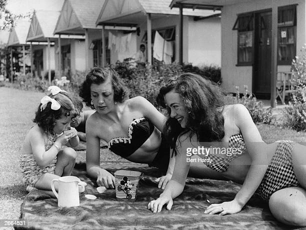 Holidaymakers sunbathing outside chalets at Butlin's holiday camp at Filey Original Publication Picture Post 6589 Picture Post Visits A Holiday Camp...