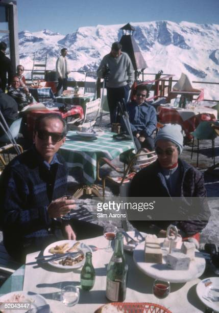 Holidaymakers take a glass of wine in an outdoor cafe at Courchevel in France 1963