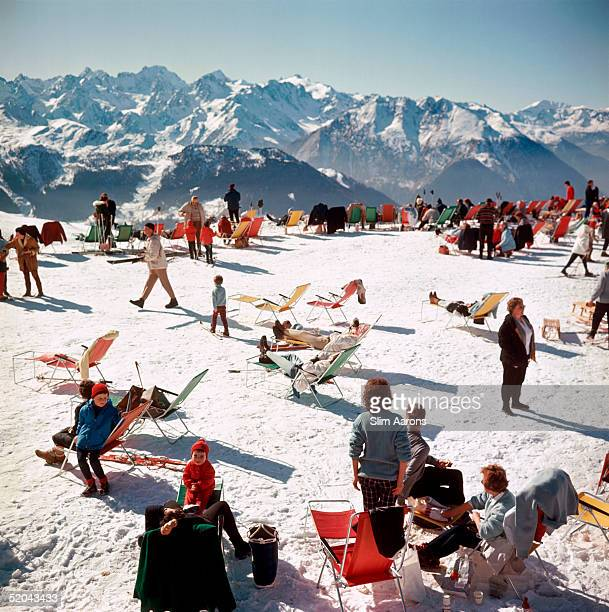 Holidaymakers take the sun on a mountain top in Verbier 1964