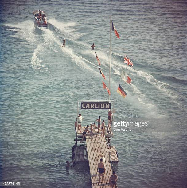 Holidaymakers waterskiing from the pier of the Carlton Hotel Cannes 1958