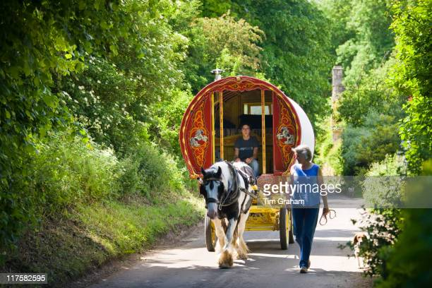 Holidaymakers with romany caravan in the country lanes of the Cotswolds Swinbrook Oxfordshire UK