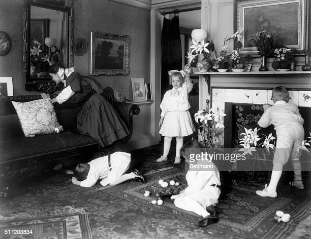 US Holidays and how the children celebrated them Hunting for Easter eggs Living room of a fashionalbe home with seasonally decorated fireplace...