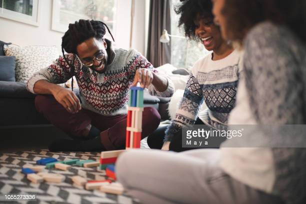 holidays bring  family together - board game stock pictures, royalty-free photos & images