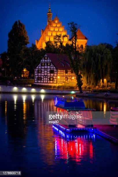 holidays in poland - brda river and mill island in bydgoszcz by night - bydgoszcz stock pictures, royalty-free photos & images