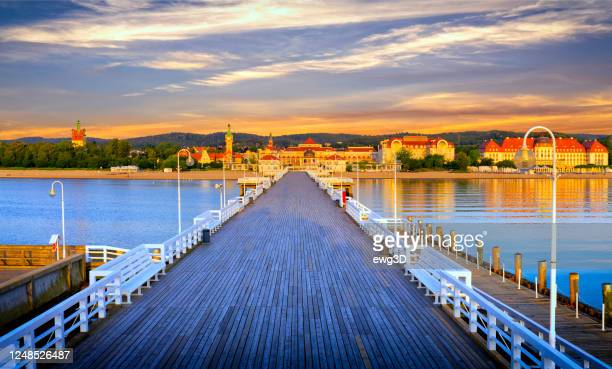 holidays in poland - the pier at dawn in sopot - poland stock pictures, royalty-free photos & images