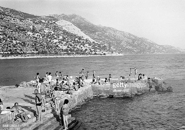 Holidays, tourism, bathing tourists, people take a sunbath, Croatia, at that time Jugoslavia, Yugoslavia, Mediterranian Sea, Adriatic Sea -