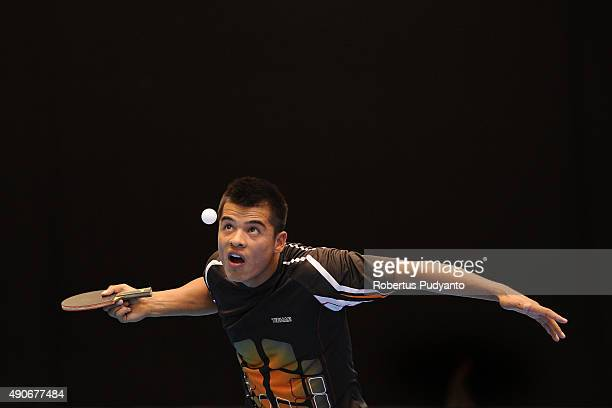 Holikov Elmurod of Uzbekistan competes against Udomsilp Chanakarn of Thailand during Men's singles first round match of the 22nd 2015 ITTF Asian...