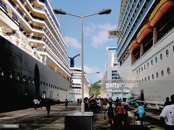 Holland America Line cruise ship Westerdam on left, Carnival Victory forward left, Golden Princess forward right, and Royal Caribbean's Mariner of...