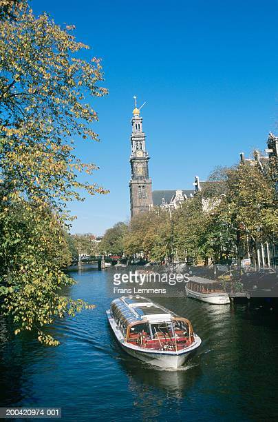 Holland, Amsterdam, Prince's Canal, Westerkerk and tour boat on canal