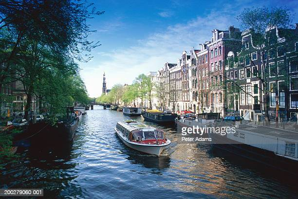 holland, amsterdam, sight seeing boat on canal - amsterdam stock pictures, royalty-free photos & images