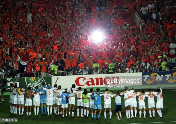 Holland celebrate with their fans after defeating Sweden in the penalty shoot out during the UEFA Euro 2004, Quarter Final match between Sweden and...