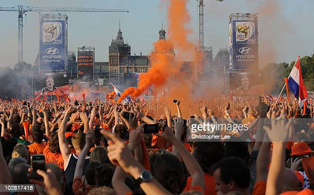 Holland fans cheer and let off flares as they watch the FIFA2010 World Cup final between Netherlands and Spain on a large screen near the Rijksmuseum...