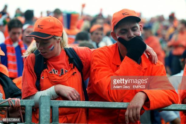 Holland fans dejected after the game as their World Cup dreams are in shatters