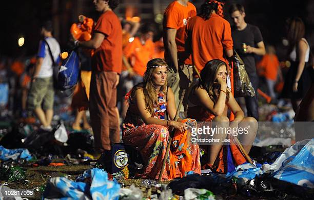 Holland fans look dejected after watching the Netherlands lose the FIFA2010 World Cup final between Netherlands and Spain on a large screen near the...