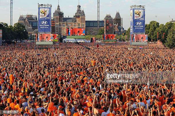 Holland fans seem as a sea of orange as they watch the FIFA2010 World Cup final between Netherlands and Spain on a large screen near the Rijksmuseum...