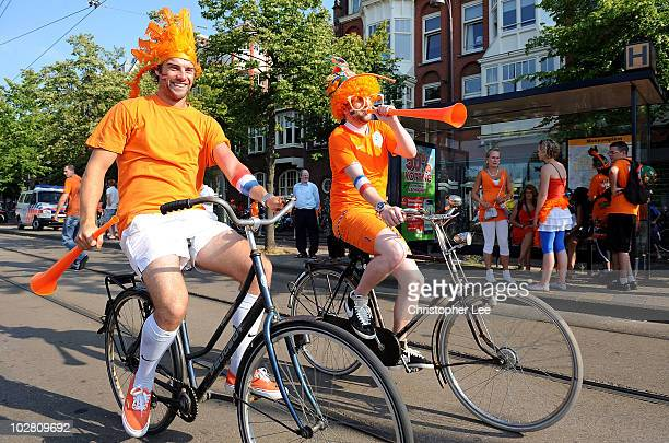 Holland fans show off their orange colours as they arrive to watch the FIFA2010 World Cup final between Netherlands and Spain on a large screen near...