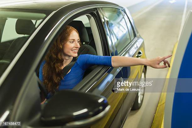 Holland, Goirle, young woman parking car