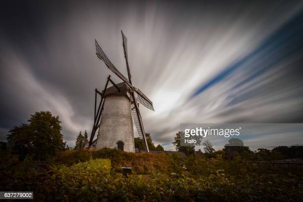 Holland old windmill with clouds, long exposure