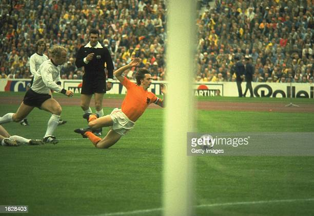 Holland player Johan Cruyff is tripped by Uli Hoeness of Germany for a penalty kick in the 1st minute of the game watched by referee Jack Taylor...