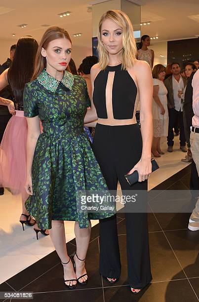 Holland Roden and Laura Vandervoort attend the Jovani LA Flagship Opening on May 24 2016 in Beverly Hills California