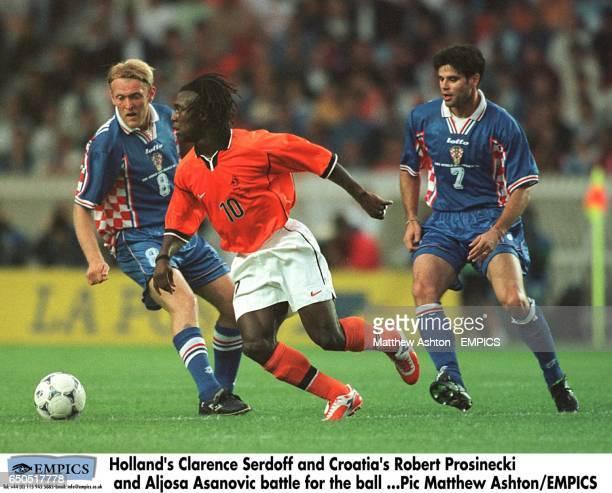 Holland's Clarence Seedorf cuts between Croatia's Robert Prosinecki and Aljosa Asanovic