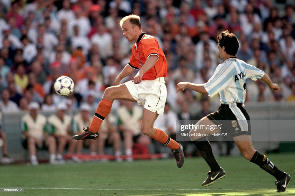 Holland's Dennis Bergkamp (left) controls the ball before scoring the winning goal