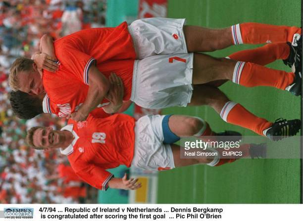 Holland's Dennis Bergkamp is congratulated after scoring the first goal