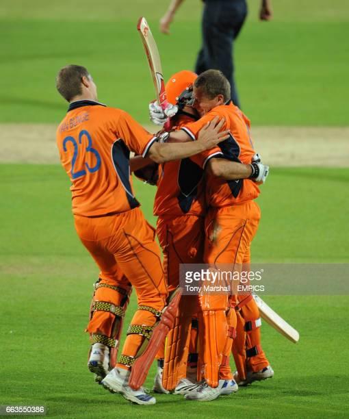 Holland's Edgar Schiferli celebrates with Ryan ten Doescchate and Daan Van Bunge after beating England