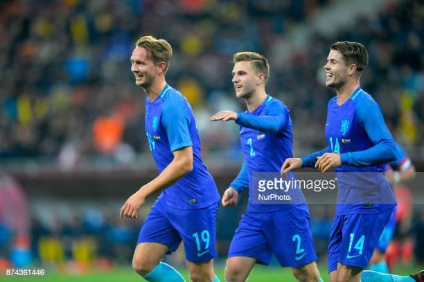 Holland's Look de Jong Joël Veltman and Marco van Ginkel celebrates after the goal of Luuk de Jong during International Friendly match between...